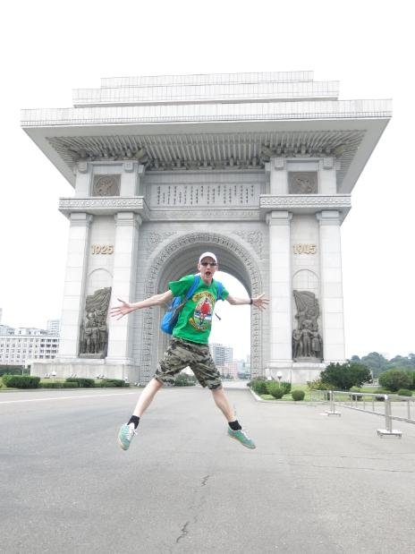 Jonny Blairs travel blog Dont Stop Living jumping outside the Arc de Triumph in Pyongyang North Korea